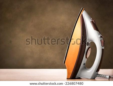 Smoothing-iron on an ironing board - stock photo