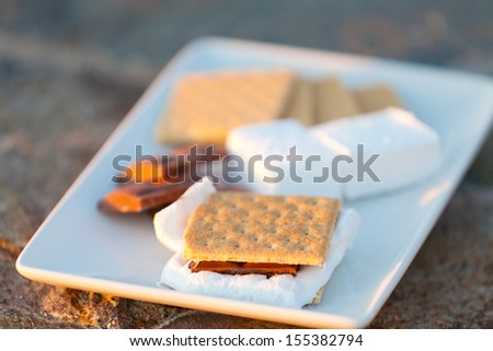 smores, marshmallow, chocolate and graham crackers ready on plate, shallow DOF - stock photo