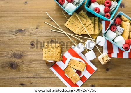 Smores with white chocolate and fresh raspberries. - stock photo