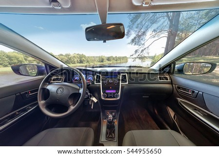 SMORGON, BELARUS - NOVEMBER 24, 2014: Interior of Geely Emgrand CS7 is near the river in the forest