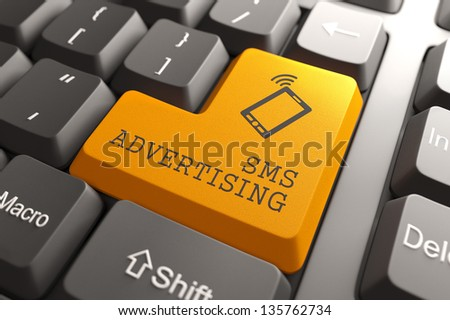 SMS Advertising Concept. Orange Button on Computer Keyboard. 3D Render. - stock photo