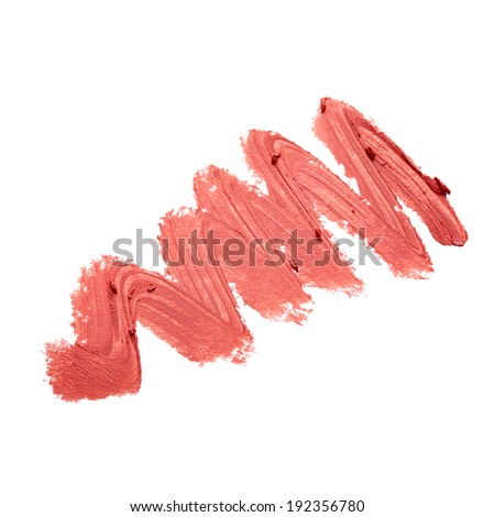 Smudged lipstick over white background - stock photo