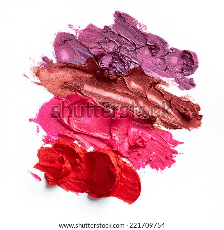 Smudged lipsticks isolated on white background - stock photo