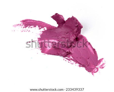 Smudged purple lipstick isolated on white background