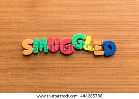 smuggled colorful word on the wooden background - stock photo