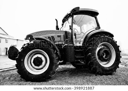 SMYKIVTSI, UKRAINE - MARCH 24, 2016: Black and white photo of tractor in snowy weather