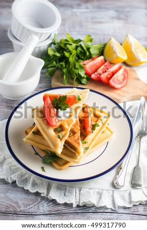 snack Belgian waffles with cheese and tomatoes