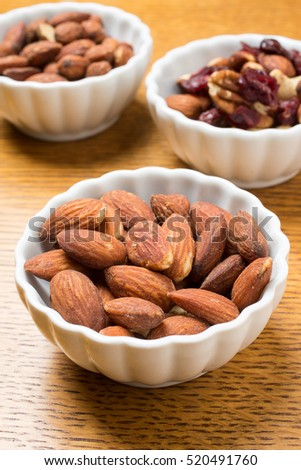 Snack bowls full of an healthy assortment of nuts.