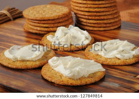 Snack crackers with cream cheese with chives and green onion - stock photo