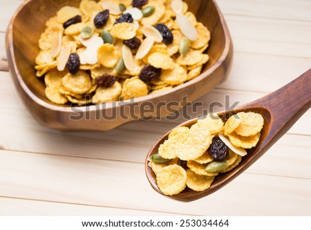 snack made from cornflakes cereal and caramel with ingredient of raisin, pumpkin seed and slice almond - stock photo