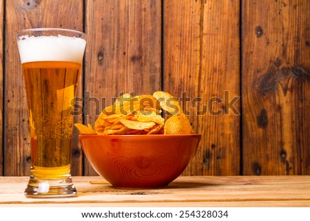 Snack potato chips and beer - stock photo