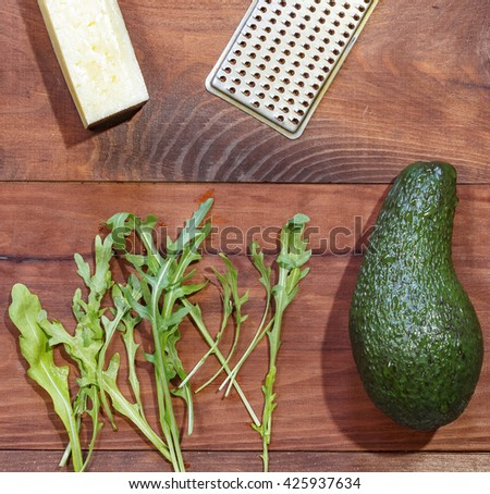 Snack to wine. Avocado, arugula and Parmesan - stock photo
