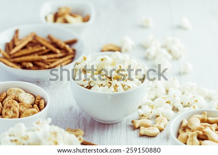 Snacks on wooden background - stock photo