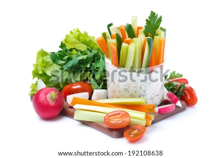 snacks - vegetables with yogurt sauce in a glass and fresh herbs, isolated on white - stock photo
