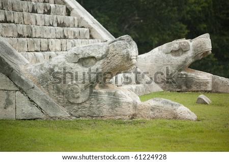 Snake Head Monuments At The El Castillo Temple, Chichen Itza, Mexico - stock photo