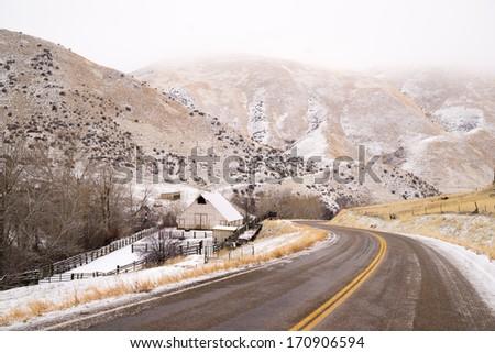 Snake River Valley Ranch Snow Falls Rural Farm House - stock photo