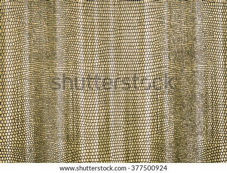 Snakeskin print curtain illustration in pale gold brown for use as a background or texture - stock photo