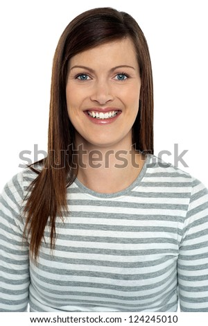 Snap shot of a cheerful young woman looking at camera, white background. - stock photo