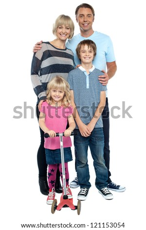 Snap shot of a complete family isolated against white. Full length studio shot. - stock photo