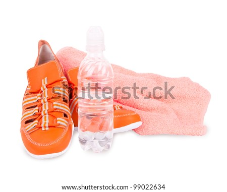sneakers, a towel and a bottle of water isolated on white background