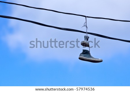 Sneakers Caught on a Telephone Wire - stock photo