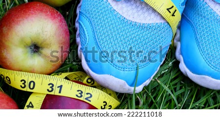 sneakers, centimeter, red apples, weight loss, running, healthy eating, healthy lifestyle concept - stock photo