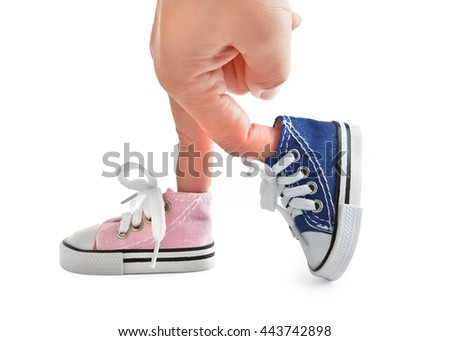 Sneakers different colors on the fingers. Isolated. - stock photo