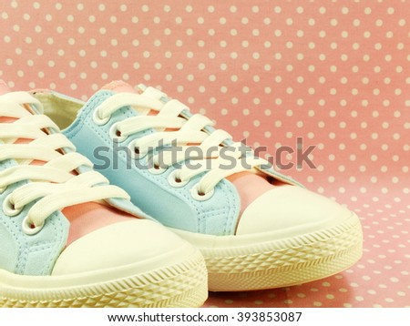 sneakers for lady with pink polka dot background