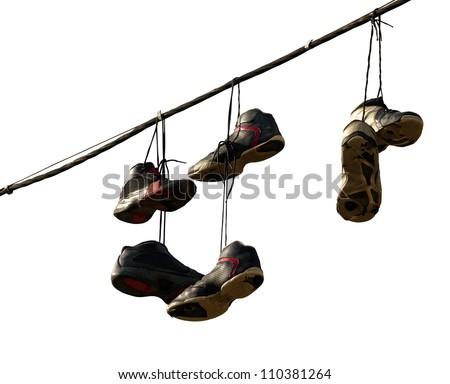 Sneakers hanging on a telephone line, urban youth joke - stock photo
