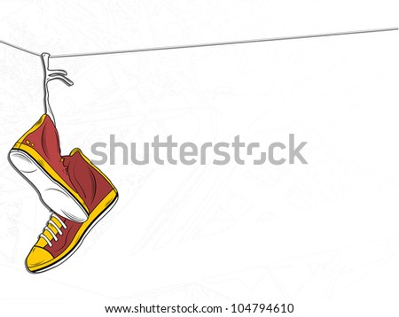 Sneakers Hanging on wire on White Background - stock photo