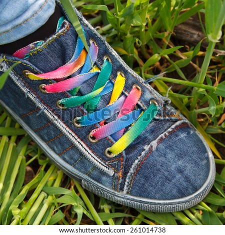 sneakers in grass - stock photo
