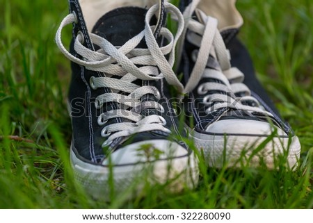 sneakers on a grass