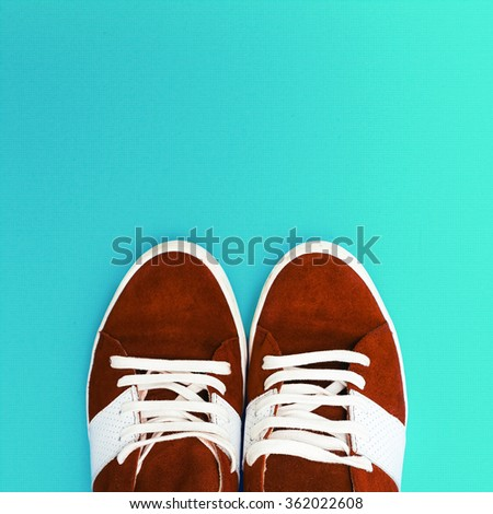 Sneakers on blue background. City Style - stock photo