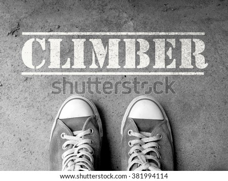 Sneakers on concrete floor background with text : Climber