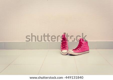 Sneakers on floor - stock photo