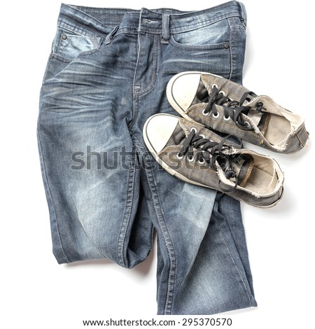 sneakers on jean pants isolated on white background - stock photo