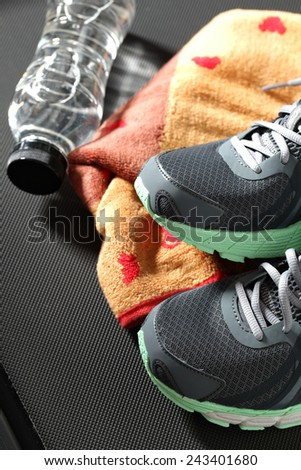 Sneakers on the treadmill - stock photo