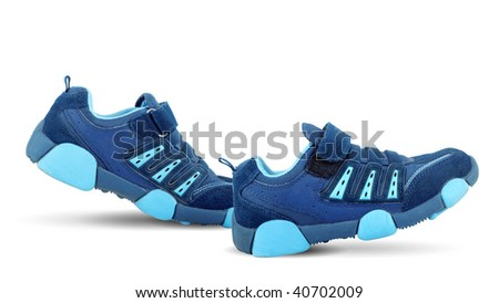 Sneakers walking by themselves - stock photo