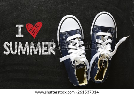 Sneakers with I love summer. Male sneakers with I love summer on the back background - stock photo