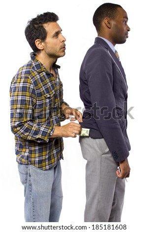sneaky man stealing cash from a victim - stock photo
