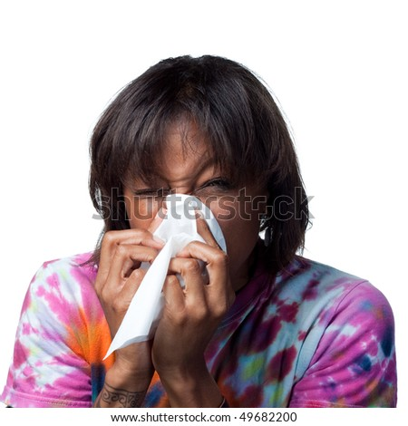 Sneezing into a tissue - stock photo