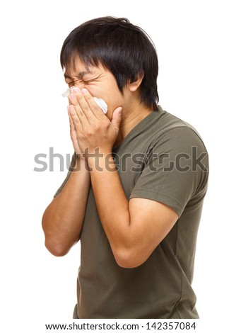 Sneezing man - stock photo