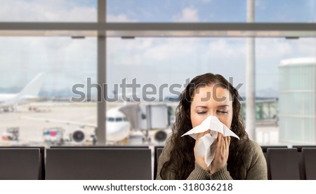 sneezing woman sick blowing nose with white background - stock photo