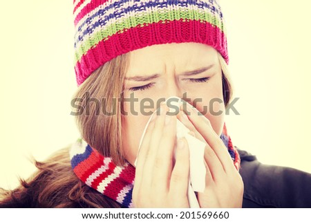 Sneezing woman with handkerchief, close up. - stock photo
