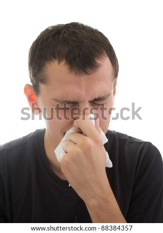 Sneezing young man