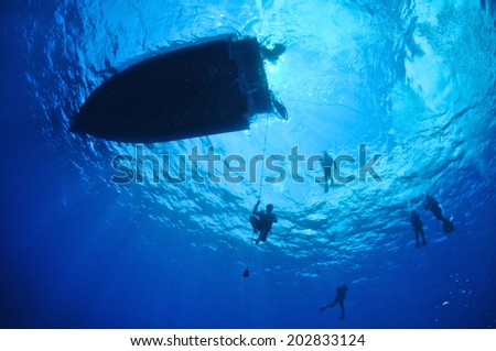 Snell's Wiindow with Dive Boat and Diver silhouette, Grand Cayman - stock photo