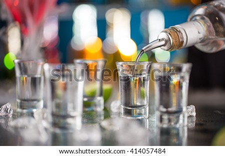 Snifters on bar desk, close-up. - stock photo