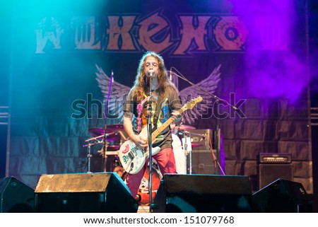 SNINA, SLOVAKIA - AUGUST 9: Guitarist and singer Ota Hores of the band Alkehol performs on music festival Rock pod Kamenom in Snina, Slovakia on August 9, 2013 - stock photo