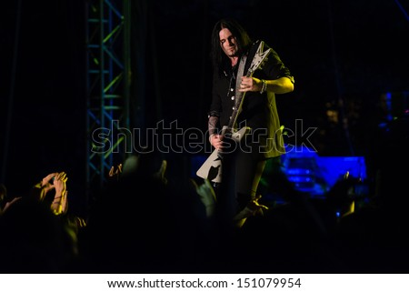 SNINA, SLOVAKIA - AUGUST 10: Sascha Gerstner - guitarist of the metal band Helloween performs on music festival Rock pod Kamenom in Snina, Slovakia on August 10, 2013 - stock photo