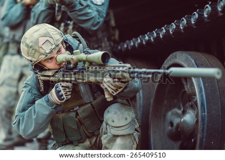 Sniper aim at a target of sniper rifle - stock photo